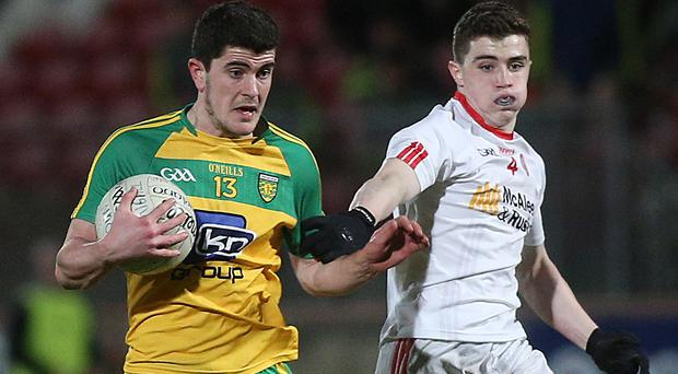 Donegal's Niall O'Donnell and Tyrone's Conor Shields battle it out during the U-21 Football Championship.