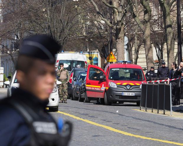 French police officers take position after letter bomb exploded at the French office of the International Monetary Fund, lightly injuring one person, Thursday, March 16, 2017. A police official said no other damage was been reported in the incident. (AP Photo/Thibault Camus)