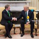 US President Donald Trump shakes hands with the Taoiseach of Ireland Enda Kenny (L) during a meeting in the Oval Office of the White House in Washington, DC, March 16, 2017. / AFP PHOTO / SAUL LOEBSAUL LOEB/AFP/Getty Images