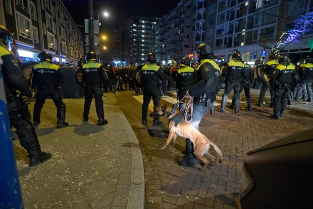Dutch riot police charges after riots broke out at a pro Erdogan demonstration outside the Turkish consulate in Rotterdam, Netherlands, Sunday, March 12, 2017. (AP Photo/Peter Dejong)