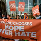 Members of campaign group Avaaz welcome the victory of the Liberal VVD party in the general elections, at the Buitenhof entrance of the Dutch parliament in The Hague on March 16, 2017. AFP/Getty Images