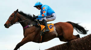 Jumping for joy: Un de Sceaux successfully negotiates a fence under the guidance of Ruby Walsh en route to victory in the Ryanair Chase, one of four triumphs for the jockey and trainer Willie Mullins on day three of the Cheltenham Festival