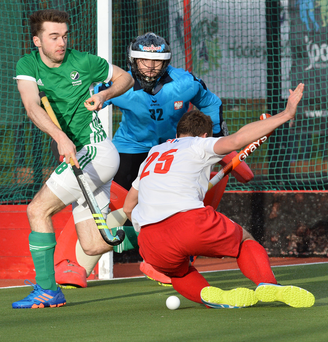 Fierce battle: Ireland's Johnny McKee and Adrian Krokosz of Poland fight for possession at Stormont