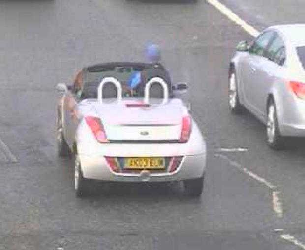 CPS North East handout image taken from ANPR footage dated 26/01/16 of Adam Elliot driving a Ford Ka through Newcastle, as the 6ft 6in car dealer who drove the small convertible while sitting on the headrest, steering with with his knees and waving to other drivers has narrowly escaped jail, a judge said. PA