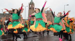 Dancers from St. Cecilia's College leap in the air as they make their way past the Guildhall during Derry City and Strabane District Council's the annual Spring Carnival on St. Patrick's Day in Derry-Londonderry. Picture Martin McKeown. Inpresspics.com. 17.03.17