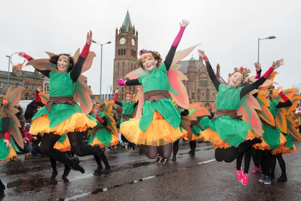 Flashback to 2017..... Dancers from St. Cecilia's College leap in the air as they make their way past the Guildhall during Derry City and Strabane District Council's the annual Spring Carnival on St. Patrick's Day in Derry-Londonderry. Picture Martin McKeown. Inpresspics.com. 17.03.17