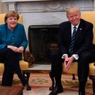 WASHINGTON, DC - MARCH 17: German Chancellor Angela Merkel (L) meets with U.S. President Donald Trump in the Oval Office of the White House on March 17, 2017 in Washington, DC. This is Merkel's first visit to the U.S. under the Trump administration. (Photo by Pat Benic-Pool/Getty Images)