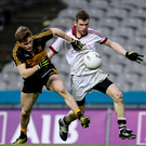 Race is on: Slaughtneil ace Francis McEldowney battles with Gavin White of Dr Crokes
