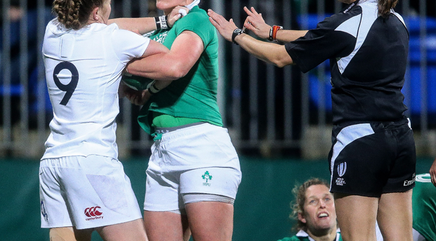 Up close: Ireland's Lindsay Peat gets to grips with England's La Toya Mason
