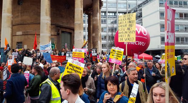 People gather outside the BBC offices in Portland Place, near Oxford Street, London to march against racism amid debates about the place of migrants in Britain after exit from the European Union. PA