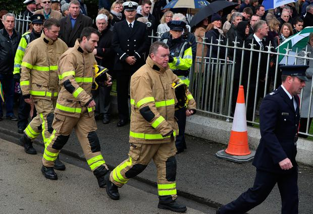Members of the Fire service arrive for the funeral of Captain Dara Fitzpatrick, who died in the Coast Guard helicopter tragedy off Blacksod, Co Mayo at St Patrick's Church, Glencullen. PA