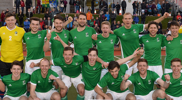 Golden boys: The Irish squad celebrate their World League 2 tournament success after beating France in a shoot-out in the final, staged at Stormont's Playball