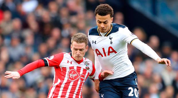 Pitched battle: Dele Alli tussles with Saints' Steven Davis