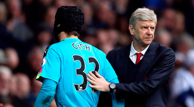 Czech mate: Arsene Wenger shakes hands with his goalkeeper Petr Cech as he is substituted
