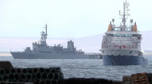 The Irish Naval Service vessel L.E. Eithne (rear) and the search vessel Granuaile in Blacksod Bay, Co. Mayo, Ireland, as the search continues for an Irish Coast Guard helicopter which went missing off the west coast of Ireland.