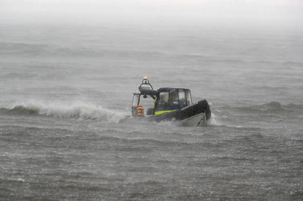 A Garda Water Unit rib during bad weather in Blacksod Bay, Co. Mayo, Ireland, as the search continues for an Irish Coast Guard helicopter which went missing off the west coast of Ireland. PA