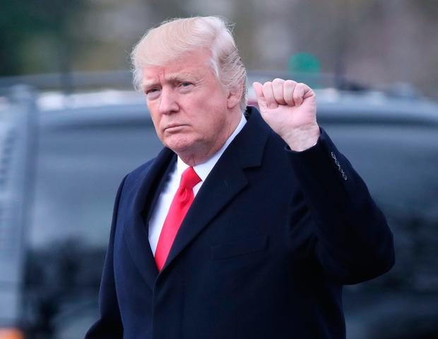 US President Donald Trump walks to Marine One while departing from the White House, on March 20, 2017 in Washington, DC. (Photo by Mark Wilson/Getty Images)