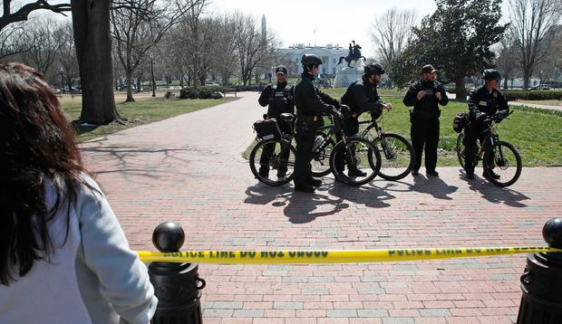 US Secret Service officers stand in the cordoned off Lafayette Park after a security incident near the fence of the White House in Washington, Saturday, March 18, 2017. (AP Photo/Alex Brandon)