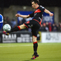 Net buster: Paul Heatley hooks home a stunning strike to put Crusaders in front at Seaview
