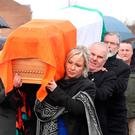 The coffin of Northern Ireland's former deputy first minister and ex-IRA commander Martin McGuinness is carried to his home in Londonderry by Gerry Adams and Michelle O'Neill after he died aged 66. Pic: Niall Carson/PA Wire
