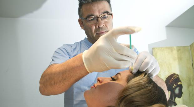 Dr Michael Tan and with Laura Dunlop at Therapie Clinic, Royal Avenue Belfast for a botox treatment.