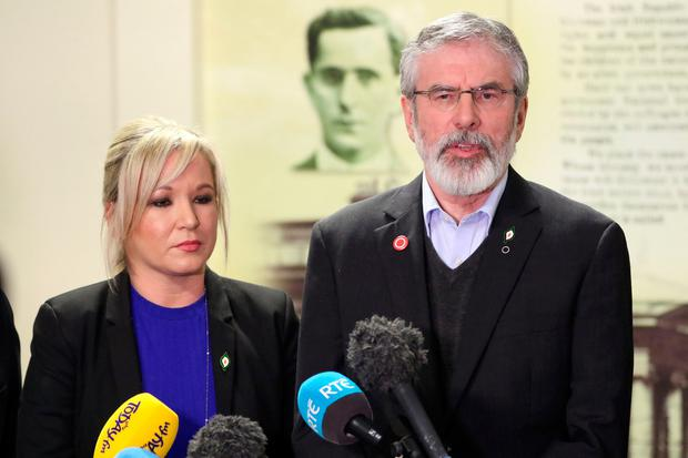 Sinn Fein President Gerry Adams (R) and Northern Ireland leader, Michelle O'Neill (L) speak at a press conference in the Bogside neighbourhood of Derry on March 21, 2017. AFP/Getty Images