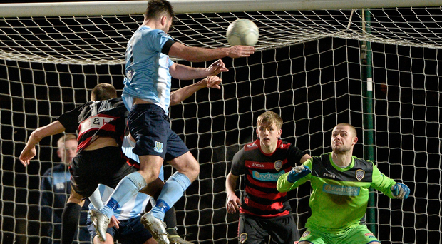 Heads up: Ballymena striker Johnny McMurray climbs high to power home his side's leveller. Photo: Stephen Hamilton/Presseye