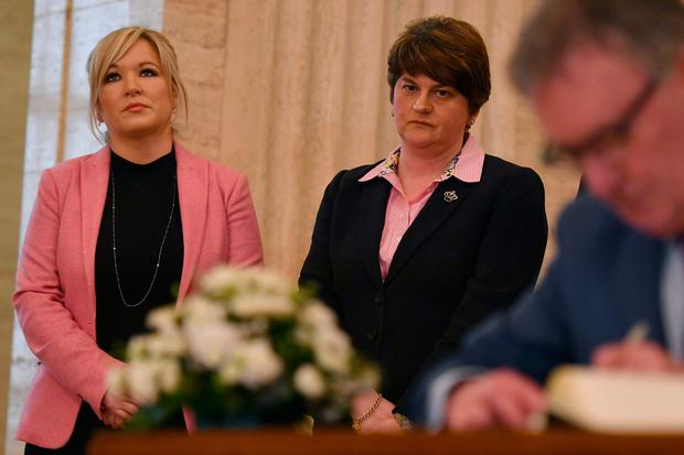 DUP leader Arlene Foster and Sinn Fein Northern Ireland Leader, Michelle O'Neill (L), sign a book of condolence for Martin McGuinness. PIC PA