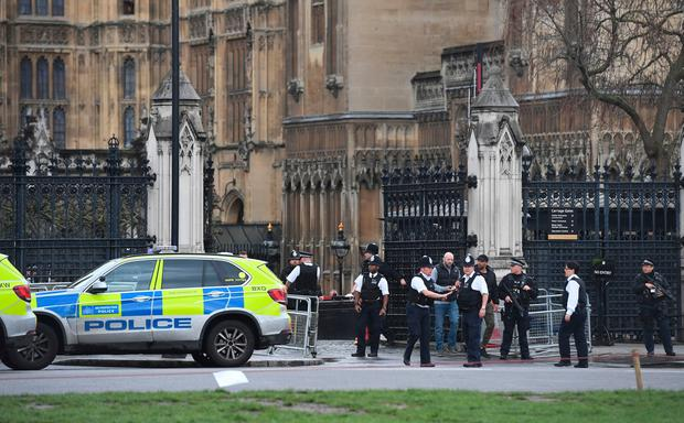 Police outside the Palace of Westminster, London, after sounds similar to gunfire have been heard close to the Palace of Westminster. A man with a knife has been seen within the confines of the Palace, eyewitnesses said. Victoria Jones/PA Wire