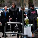 Grenoble's Irish centre Chris Farrell (2ndL) and Grenoble's Irish prop Denis Coulson (R) arrive on March 21, 2017 at the police station in Grenoble, French Alps. Six Grenoble rugby players including two Irishmen, two New Zealanders and an Australian, were detained on March 21, 2017 following a rape complaint, prosecutors said. / AFP PHOTO / JEAN-PIERRE CLATOTJEAN-PIERRE CLATOT/AFP/Getty Images