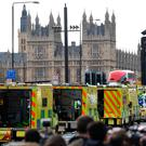 Ambulances wait as members of the emergency services work on Westminster Bridge.
