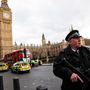 An armed police officer stands guard near Westminster Bridge and the Houses of Parliament on March 22, 2017 in London, England. (Photo by Jack Taylor/Getty Images)