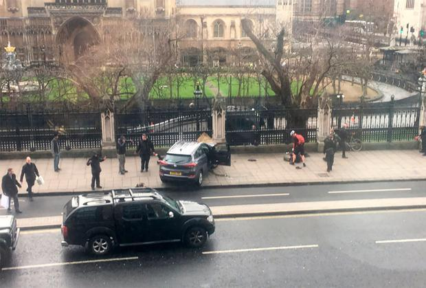 A picture obtained from the Twitter account of James West, shows a car stopped on the sidewalk in front of the Palace of Westminster which houses the Houses of Parliament in central London on March 22, 2017 during an incident. James West/Getty