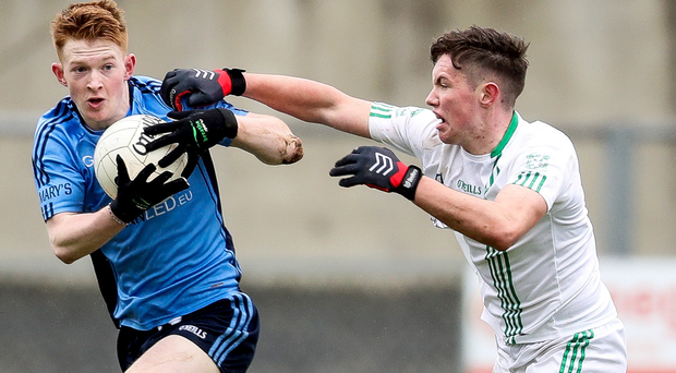 Hold on: St. Peter's Conchuir Firman tackles Declan Cassidy of St. Mary's
