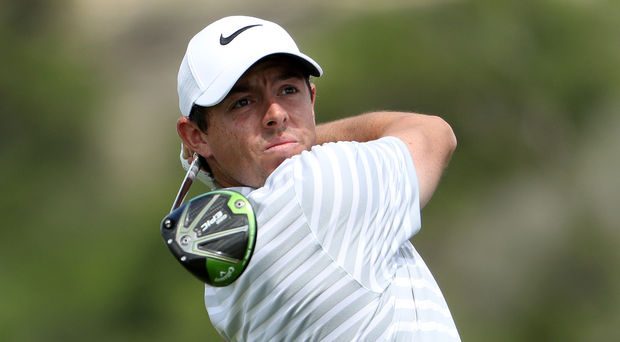 Poor start: Rory McIlroy tees off on the 13th hole during his loss to Soren Kjeldsen yesterday