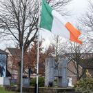 The Irish Tri-colour flies at half mast close to Free Derry Corner following the death of Martin McGuinness.