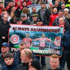 Mourners at the funeral of Derry City football captain Ryan McBride travels to the Long Tower church in Londonderry, he was found dead at home on Sunday night aged 27. Niall Carson/PA Wire