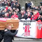 Funeral of Derry City Football Club captain Ryan McBride at St Columba's Church in the city. The 27-year-old died suddenly at his home on Sunday evening. His coffin is carried from the church after Requiem Mass. Picture by Jonathan Porter/PressEye.com