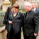 Arlene Foster and Bishop John McKeown arriving for the funeral of Northern Ireland's former deputy first minister and ex-IRA commander Martin McGuinness, at St Columba's Church Long Tower, in Londonderry. Niall Carson/PA Wire