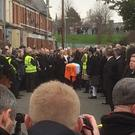 Singing of Raglan Road over Martin McGuinness coffin.