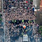 The funeral cortege of Martin McGuinness passes through the streets of Derry on March 23, 2017 in Londonderry.