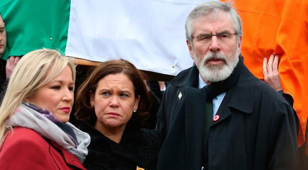 Sinn Fein's Michelle O'Neill (left) Mary Lou McDonald (middle) and Gerry Adams (right) during the funeral procession of Northern Ireland's former deputy first minister and ex-IRA commander Martin McGuinness, ahead of his funeral at St Columba's Church Long Tower, in Londonderry. PRESS ASSOCIATION Photo. Picture date: Thursday March 23, 2017. See PA story FUNERAL McGuinness. Photo credit should read: Thomas McMullan/PA Wire