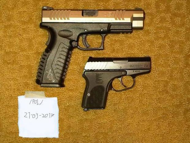 4chan post also contained a photo, taken from the internet, of two guns
