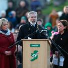 (left to right) Sinn Fein's Michelle O'Neill, Gerry Adams and Mary Lou McDonald speak at Derry City Cemetery, in Londonderry, after the funeral service of Northern Ireland's former deputy first minister and ex-IRA commander Martin McGuinness. PRESS ASSOCIATION Photo. Picture date: Thursday March 23, 2017. See PA story FUNERAL McGuinness. Photo credit should read: Brian Lawless/PA Wire