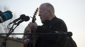 Christy Moore singing at Martin McGuinness's funeral. Photo Mark Marlow/Pacemaker Press