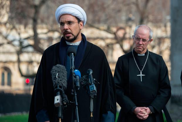 Sheikh Mohammad al Hilli (L) speaks beside Archbishop of Canterbury, Justin Welby during a vigil outside Westminster Abbey in London March 24, 2017, two days after the March 22 terror attack on the British parliament and Westminster Bridge. AFP/Getty Images
