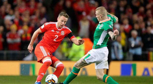 Wales' Chris Gunter and Republic of Ireland's James McClean during the 2018 FIFA World Cup Qualifying, Group D match at the Aviva Stadium, Dublin. Pic Niall Carson/PA Wire.