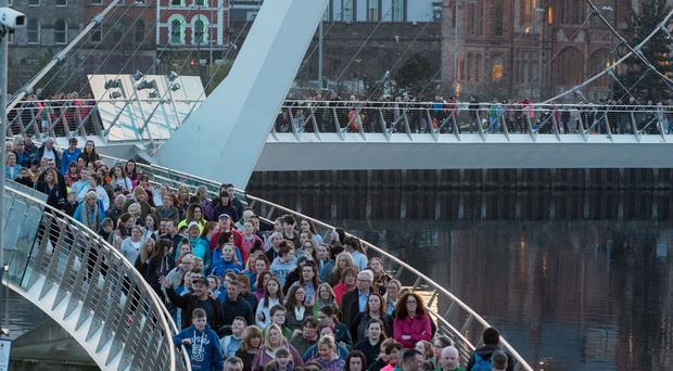 People cross Derry's Peace Bridge during the Memorial Walk in memory of The McGrotty, Daniels family; Sean McGrotty (48) Mark McGrotty, (12) Evan McGrotty, (8) Jodie-Lee Daniels,(14) and Ruth Daniels (58) who lost their lives at Buncrana Pier on Sunday March 20, 2016. Martin McKeown. Inpresspics.com. 24.03.17