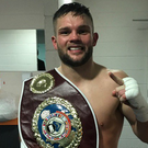 Champion: Conrad Cummings celebrates European title glory in Edinburgh last night after victory over Gogi Knezevic