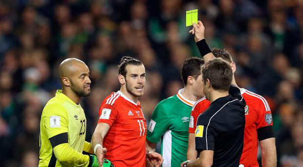 Wales' Gareth Bale gets a yellow card during the 2018 FIFA World Cup Qualifying, Group D match at the Aviva Stadium, Dublin. PA